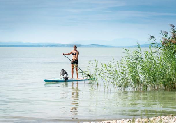 Ike Hodits doing stand-up paddling on Lake Neusiedl