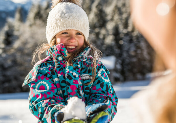 SalzburgerLand: Dear Winter, you are my favourite fairytale! A girl is having fun in the snow