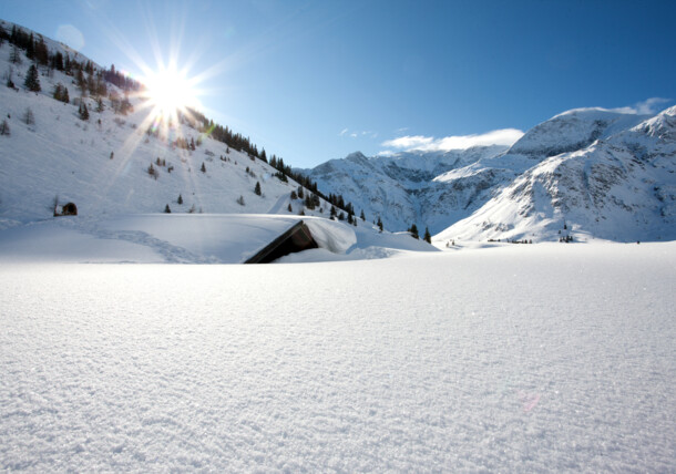 Winter landscape - snow-covered hut